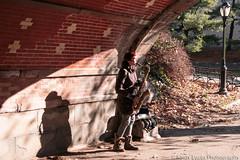 31 Street Candid (Kirsty Lucas Photography) Tags: centralpark central park newyork new york musician saxaphone street candid woman usa bridge shadow