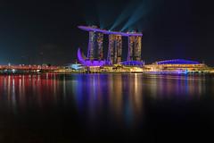 Singapore Skyline (mclcbooks) Tags: landscape cityscape singapore water reflections night lights lightshow artsciencemuseum marinabaysands helixbridge