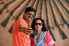 Weaponized Selfie (Pedestrian Photographer) Tags: city palace jaipur weapons wall display couple phone selfie sunglasses india indian