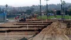 (Rich T. Par) Tags: pomona phillipsranch socal southerncalifornia losangelescounty lacounty constructionsite california palmtrees tree suburb dirt civilengineering sky frontloader heavyequipment parkinglot fence chainlinkfence road constructionvehicles tractor truck