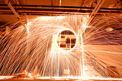 Fire Spinning In Middle Of Gigantic Production Floor (@mjmantis Montreal Urban Photos) Tags: canada urbex firespinning night montreal indoors industry fire abandoned lightpainting mtl urbanphotography urbanart interior industrial nightphoto