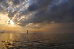 Drama over the Frankfort Light (mjhedge) Tags: sunset sky sun clouds water lighthouse light dramatic getolympus oly olympus omdem5 em5 1250mm frankfort michigan lakemichigan puremichigan skylum