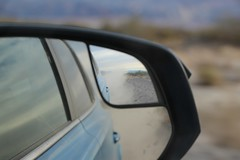 1101 Dust clouds in our rear-view mirror as we blast along the easy-driving West Side Road in Death Valley (_JFR_) Tags: camping hiking deathvalley deathvalleynationalpark dustclouds westsideroad