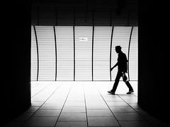 The man between the lines (Sandy...J) Tags: street streetphotography sw schwarzweis strasenfotografie silhouette monochrom man alone light lines urban underground station walking olympus blackwhite bw city germany absoluteblackandwhite