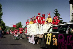 71-444 (ndpa / s. lundeen, archivist) Tags: nick dewolf nickdewolf color photographbynickdewolf 1975 1970s film 35mm 71 reel71 summer fall aspen colorado september parade homecomingparade homecoming ahs aspenhighschool highschool mainstreet 82 highway82 co82 building hotel jerome hoteljerome bluesky float classof79 32 12 85 65 55 footballjersey footballjerseys footballplayers footballplayer footballhelmet footballhelmets devil devils horns girl girls youngwoman youngwomen tow towing car stationwagon sign wagon