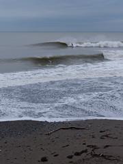 grey day Aberystwyth 1 (watcher330) Tags: aberystwyth sea beach log surf surfer seaspray