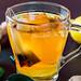 Cup with tea bag green tea close up