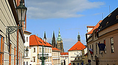 The Street that goes towards the Prague Castle - N1 (mariagrandi985) Tags: street streetphotography streetlamp lamps oldlamp streetlamps architecture roofs tower towerclock belltower clocktower windows perspective composition perfectcomposition learningcomposition sky skyandclouds bluesky buildings buildingsandclouds buildingwithtower pragueczechrepublic praguecastle iloveprague travel travelplanet nationalgeographic photojournalism history historyaroundus historicbuilding historicsite historicarchitecture uploadedonnovember102018 mariagrandi985 flags czechrepublicflag europeanunionflag europe europa capitalsofeurope flag flagsofanycountry