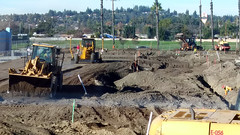 (Rich T. Par) Tags: pomona phillipsranch socal southerncalifornia losangelescounty lacounty constructionsite constructionvehicles california palmtrees tree suburb tractor dirt civilengineering grader sky frontloader steamroller roadroller civilengineers heavyequipment trench excavator