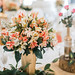 Flowers as center pieces at wedding table