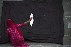 Repair Mode (Pedestrian Photographer) Tags: blanket quilt repair sew sewing roof rooftop girl red arm jaipur india