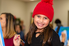 Big Smile and a Red Knit Cap (Kevin MG) Tags: paint school painting event schoolgirls cute pretty little young youth adolescent adorable smile portrait ns1