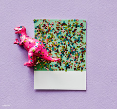 Colorful  and cute miniature dinosaur figure (Rawpixel Ltd) Tags: abstract animal background card colorful confetti craft cute decoration decorative design dino dinosaur disco effect festive glamour glitter glittery glow glowing green macro metallic name ornament paper pastel pattern pink purple retro sequin shimmer shine shiny sparkling sparkly textile texture textured wallpaper