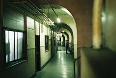 Movers (tripl8_i) Tags: tokyo tukiji 東京 築地市場 yashica electo35mc yashinondx 40mm28 curved corridor