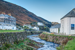 Winter Blues At Boscastle - Cornwall. (john lunt) Tags: boscastle cornwall cornish fishing village river outlet water meandering twisting bridge buildings white render stone old historic flood green grass blue sky bronze bracken autumn autumnal winter fall outofseason quiet peaceful tranquil holiday vacation destination england uk britain english tourism british travel horizontal colour color landscape hdr tone mapped john lunt beautiful earlymorning sonyalphaa7r2 zeiss55mmf18za prime lens