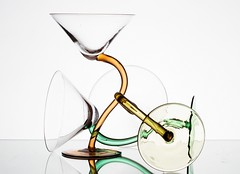 Tangled (Karen_Chappell) Tags: glass white pastel three glasses curves stemware glassware stilllife green orange yellow shape curve abstract shapes