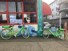 Lime bikes in the U District (Seattle Department of Transportation) Tags: seattle sdot transportation seattlesqueeze squeeze lime bikes bikeshare limee university district sidewalk art store