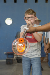 Practice Glass Blowing (aaronrhawkins) Tags: glassblowing glass molten hot shop factory tourist tourism cabosanlucas experiment bubble glow mexio baja california vacation curious boy child joshua aaronhawkins