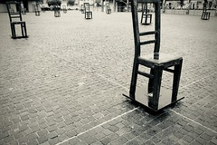Empty chairs (halifaxlight) Tags: krakow emptychairmonument ghettoheroessquare jewishghetto holocaust monument chairs ww2 nazigermany bw poland