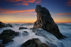 Steadfast (artjom83) Tags: australia coast longexposure nsw portmacquarie rocks seascape sunrise sunset coastal eastcoast landscape ocean pacific rock glow clouds water 2018 canon newsouthwales tacking point tide sun morning