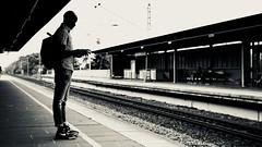 man on platform - monochrome (MLe Dortmund) Tags: monochrome schwarzweis man platform bahnsteig dortmund backlit gleise