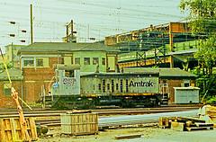 AMTRAK Endcab Switcher Number 557, Sunnyside Yard, Long Island City, NY (gg1electrice60) Tags: sunnysideyard longislandcity queens queenscounty boroughofqueens queensplaza newyorkcity nyc newyorkstate nys newyorknewyork endcabswitcher generalmotors gm emd electromotivedivision amtraknumber557 amtrakno557 amtrak557 diesellocomotive dieselengine switchengine amtrakyard switcher railyard railroadyard rryard catenary insulators sunnyside