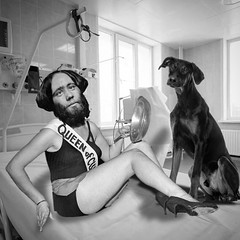 The Queen of C**** and her frying pan mirror. Everbleak observation ward, 1962. (Flamenco Sun) Tags: beautyqueen beautypageant surreal dog bed clam beardedlady freakshow weird hospital everbleak