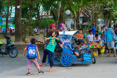 Paper Plane (Beegee49) Tags: street children school boys tricycle throwing paper play plane happy planet silay city philippines asia luminar sony a6000