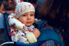 Child in a crocheted hat at the Fells Point Fun Festival, October 2/3, 1993. (scan of an old print) (A CASUAL PHOTGRAPHER) Tags: portraits children babies baby faces eyes festivals baltimore fellspointfunfestival fellspoint attendees hats crochet minoltax370 agfa agfagoldxrg200 analog