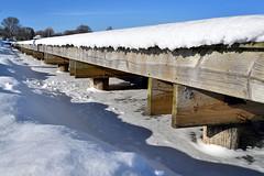 Dock in Winter (Jay Janssen) Tags: menominee park oshkosh wisconsin winter boat dock ice snow lake winnebago