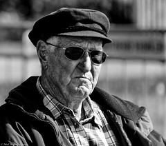 Fed UP. (Neil. Moralee) Tags: neilmoralee neilmoraleenikond7200 fed up man male old mature face portrait candid germany hat glasses sun sunnies dark senior citizen craggy rough sensible annoyed disapointed experience beated worn black white bw bandw blackandwhite mono monochrome nikon d7200 neil moralee sugar pension pensioner wise wisdom