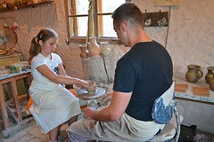 making a bowl :) (green_lover (I wait for your COMMENTS!)) Tags: martynka people workshops potter pottery work daughter girl man interior skansen poland