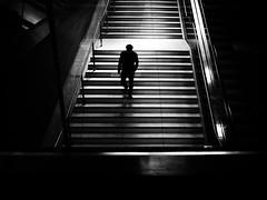 Going down (Sandy...J) Tags: urban noir atmosphere alone city street streetphotography sw schwarzweis strasenfotografie monochrom man silhouette light darkness blackwhite bw olympus germany