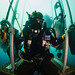 U.S. Navy Diver waits on a diving stage during a two-hour decompression stop after diving to 240 feet