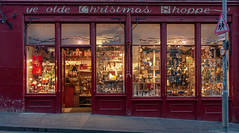 Christmas shop (Rourkeor) Tags: 145canongate 35mm 35mmzeisssonnartlens carlzeiss christmas edinburgheh88bn rx1r scotland sony uk colourful fullframe giftshop lightshadows lights reflections shopwindow windows