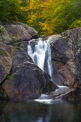 Buttermilk in Autumn (RobertCross1 (off and on)) Tags: a7rii alpha branchbrook buttermilkfalls emount fe85mmf18 greenmountains ilce7rm2 longexposure ludlow newengland sony vt vermont windsor autumn brook creek fall foliage forest fullframe landscape leaves mirrorless river rocks stream trees water waterfall