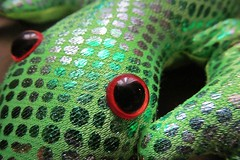 red eyes :) (green_lover (I wait for your COMMENTS!)) Tags: toy lizard eyes speckled macro macromondays picktwo green red dots round
