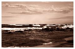 Blur (Claudio Taras) Tags: claudio controluce tramonto shadow sepia santeodoro italia sardegna spiaggia onde sabbia roccia nuvole film taras canona1 canon 50mmfd mare costa cielo baia acqua barca