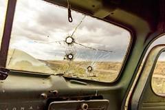 Big Rounds (garshna) Tags: window windshield international truck holes bulletholes cracked broken door dashboard sky landscape