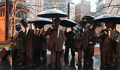 Suits In The Rain (Anthony Mark Images) Tags: suits umbrellas chicago illinois usa sculpture statues art rain chicagobusinessmen thegentlemenstatues amaplaza juming skyscrapers wetsidewalks nikon d850 themagnificentmile bronzestatues