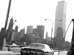 Zooming along the West Side Highway in dad's 1965 Pontiac Bonneville looking to the still-unfinished World Trade Center and the Lower Manhattan skyline. I cranked down the rear window, quickly pointed the camera and got the shot. New York. Aug 1972 (wavz13) Tags: newyorkphotographs newyorkphotos urbanphotography urbanphotos newyorkphotography manhattanphotography manhattanskyline newyorkskyline newyorkskyscrapers manhattanskyscrapers urbanlife newyorklife manhattanlife lowermanhattan lowerwestside city sky oldbuildings vintagebuildings modernbuildings urbanskylines skylines cities urban oldphotographs oldphotos 1970sphotographs 1970sphotos oldphotography 1970sphotography oldnewyorkphotography oldnewyorkphotographs oldnewyorkphotos vintagenewyorkphotography vintagenewyorkphotographs vintagenewyorkphotos vintagetribeca oldtribeca oldcadillacs vintagecadillacs 1970scadillacs antiquecadillacs oldcars vintagecars 1970scars 1960scars collectiblecars collectablecars antiquecars vintagegeneralmotors oldgeneralmotors antiquegeneralmotors highways highwayphotography
