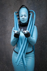 Diva Plavalaguna cosplayer at ExCeL London's MCM Comic Con, October 2018 (Gordon.A) Tags: london docklands excel excellondonexhibitioncentre mcm moviecomicmedia comicbookconvention comiccon con convention mcm2018 october 2018 creative blue costume culture subculture style diva plavalaguna fifthelement cosplay cosplayer cosplayphotography festival event eventphotography model lady woman face makeup pose posed posing wall outdoor outdoors outside amateur naturallight portrait portraitphotography colour colours color digital canon eos 750d sigma sigma50100mmf18dc