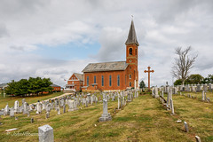 Standing Tall (John H Bowman) Tags: ohio washingtoncounty churches catholicchurches stjohnthebaptistcatholicchurch cemeteries churchyards gravestones flags usflag cloudyskies october2016 october 2016 canon16354l explore