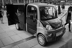 Boss car (Мaistora) Tags: truck van vehicle mini micro city urban municipal utility management load cargo pickup pedestrian crowd crowded mobile mobility service servicing canarywharf canadasquare isleofdogs docklands london england britain uk leica dlux typ109 bw blackandwhite mono monochrome film analogue classic vintage street
