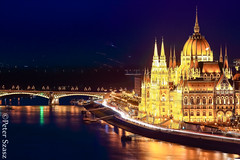 Parliament (Peter Szasz) Tags: hungary magyarország budapest city colourful urban architecture popular parlament parliament capitol cityscape night evening blue light lights trail reflection smooth october river riverbank deep water danube duna dome towers bright bridge pier boat travel