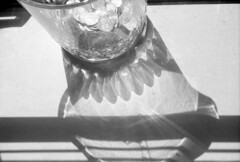untitled (kaumpphoto) Tags: mamiya nc1000s ilford 3200 bw black white crystal light refraction quarter coin stilllife abstract shadow flare contrast transparent glass money curve scallop