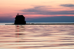 Tranquil Waters at Grand Haven (mjhedge) Tags: grandhaven lighthouse michigan lakemichigan puremichigan water reflection reflections sky evening calm tranquil getolympus oly omdem1mkii olympus omd omdem1ii 12100mm 12100mmf4 mzuiko12100mmf4pro orange sunset