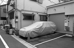 Car (Manuel Goncalves) Tags: car japan tokyo nikonn90s nikkor28mm kodaktmax400 35mmfilm blackandwhite analogue monochrome city
