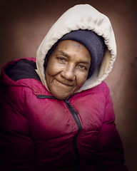 Beverly (mckenziemedia) Tags: homeless homelessness woman portrait portraiture face smile coat hat hood vignette chicago city urban street streetphotography