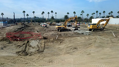 (Rich T. Par) Tags: pomona phillipsranch socal southerncalifornia losangelescounty lacounty constructionsite california palmtrees tree road suburb dirt civilengineering tubes excavator tractor heavyequipment pipes sky watertruck trench frontloader drill drillingmachine drillingtruck